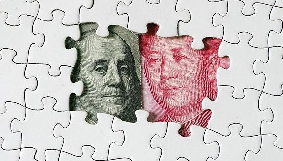 人民日报:美国对华贸易逆差根源在其自身